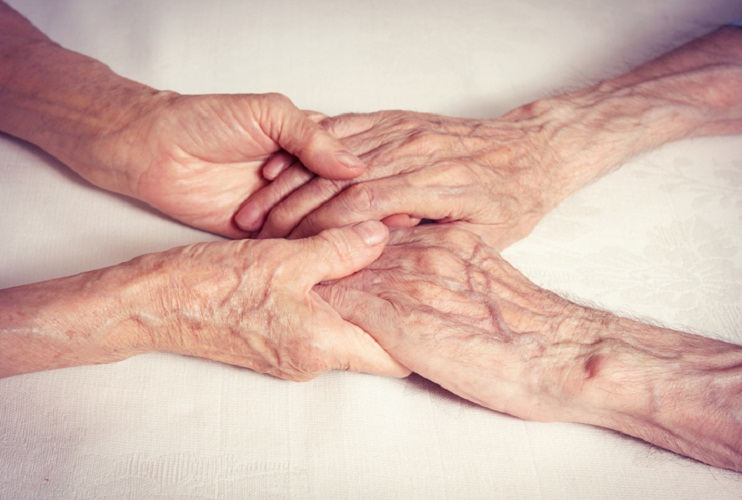 Holding aged hands